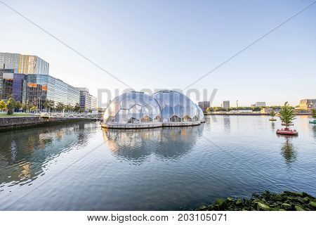 ROTTERDAM, NETHERLANDS - August 06, 2017: Morning view on the Rijn haven with floating pavilion. This construction is a hotspot for culture, festivals and other innovative events in Rotterdam