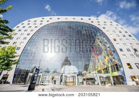 ROTTERDAM, NETHERLANDS - August 06, 2017: View on the innovative Market hall building in Rotterdam. This building has apartments and offices and was designed by architectural firm MVRDV