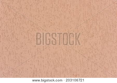 Pink wall. Gypsum plaster. The coloring of the wall.
