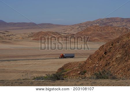 Atacama Desert, Chile - August 18, 2017: Lorry on the Pan American Highway (Ruta 5) running through the harsh and arid landscape of the Atacama in northern Chile.