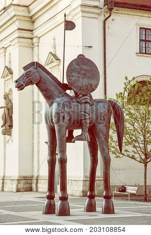 Equestrian statue of margrave Jobst of Luxembourg Brno Moravia Czech republic. Artistic symbolic object. Yellow photo filter.