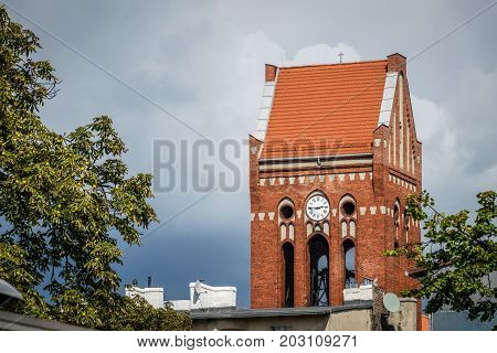 Tall bell tower of the Lutheran church located in Plac Zbawiciela in Bydgoszcz, Poland