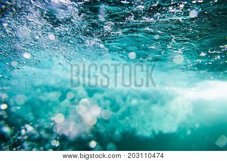 Water bubbles and wave in underwater. Turquoise water texture.