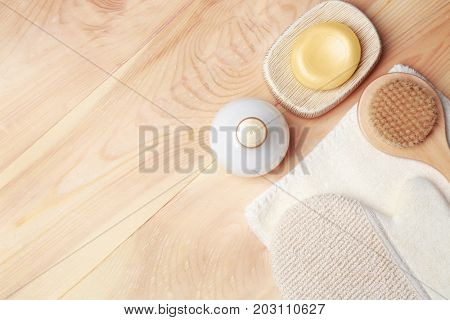 Bath accessories and cosmetics on wooden background