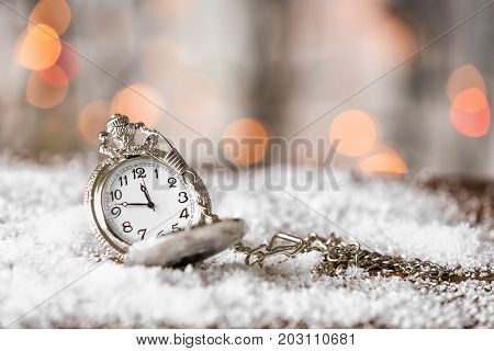 Watch on snow. Christmas countdown concept