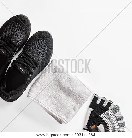 Sport shoes, gloves and towel on white background, image with Square ratio