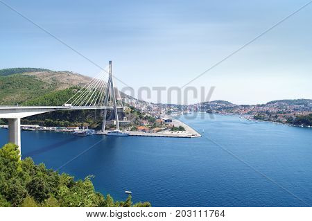 Cable-stayed bridge in Dubrovnik Croatia. Franzo Tudjman suspension bridge over the blue bay.