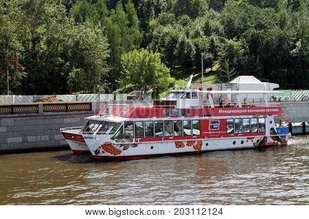 Moscow Russia - July 20 2017: Red pleasure boat sails along the Moscow River.