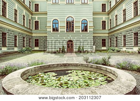 Courtyard of the forestry school in old mining town Banska Stiavnica Slovak republic. Travel destination. Old photo filter.
