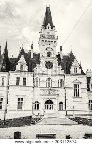 Beautiful Budmerice castle in Slovak republic. Architectural theme. Cultural heritage. Vertical composition. Travel destination. Black and white photo.
