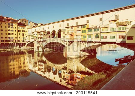 Beautiful Ponte Vecchio is mirroring in the river Arno Florence Tuscany Italy. Travel destination.