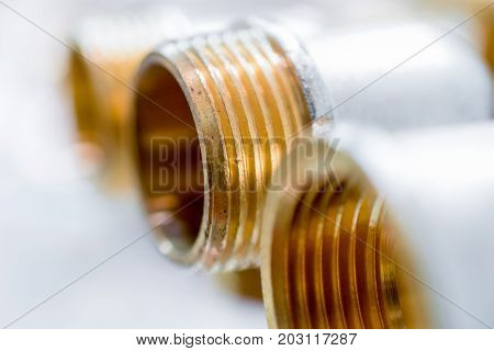 Bronze fittings for pipes. Bronze metallic threaded components.