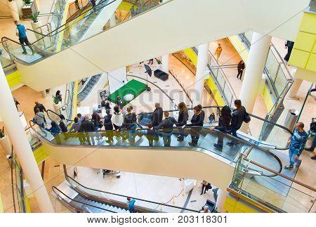 People Escalator In Shopping Mall
