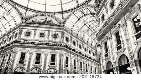 Galleria Vittorio Emanuele II in Milan city Italy Europe. Architectural theme. Shopping mall. Black and white photo.