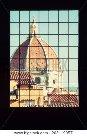 Cattedrale di Santa Maria del Fiore behind the window Florence Tuscany Italy. Retro photo filter. Architectural theme.