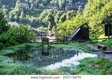 Mountain lake and country houses in the village Spania Dolina Slovak republic. Travel destination.