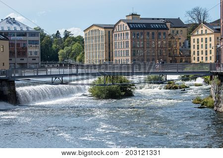 NORRKOPING, SWEDEN - AUGUST 19, 2017: The old industrial landscape and Motala stream in Norrkoping. Norrkoping is a historic industrial town in Sweden.