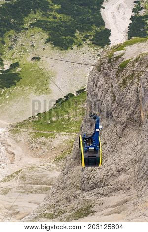 Cable Car Gondola Traveling To Dachstein Mountain Summit