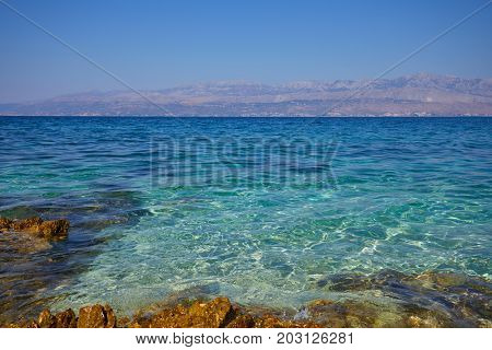 Adriatic Sea Croatia Europe. Beautiful nature and landscape photo. Warm hot summer day. Water, reef, rocks, stones and water