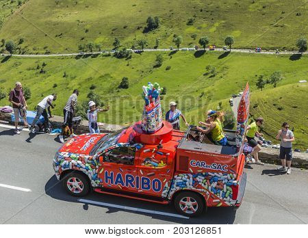 Col de PeyresourdeFrance- July 23 2014: Haribo vehicle passing in the Publicity Caravn on the road to Col de Peyresourde in Pyrenees Mountains during the stage 17 of Le Tour de France 2014.