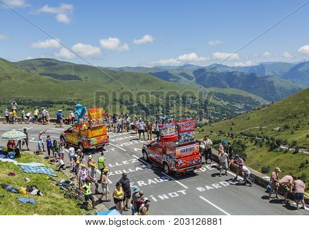 Col de PeyresourdeFrance- July 23 2014: Haribo vehicles passing in the Publicity Caravn on the road to Col de Peyresourde in Pyrenees Mountains during the stage 17 of Le Tour de France 2014.