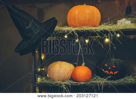Hand made Halloween. scissors, thread, needle on an old wooden background. Cute Halloween characters. decorative pumpkins. Master Class
