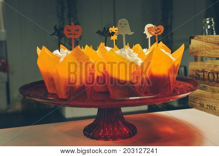 Hand made cake Halloween. scissors, thread, needle on an old wooden background. Cute Halloween characters. decorative pumpkins. Master Class