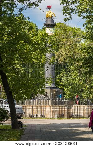 POLTAVA, UKRAINE - May 15, 2017: Monument of Glory with the fixed State Flag of Ukraine and the flag of the Organization of Ukrainian Nationalists and a poster with the inscription Glory to Ukraine