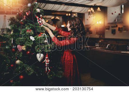 sexy young women decorating Christmas tree x-mas.