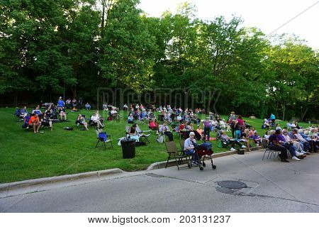 JOLIET, ILLINOIS / UNITED STATES - JUNE 1, 2017: An audience gathers for an outdoor Concert on the Hill in the Billie Limacher Bicentennial Park.