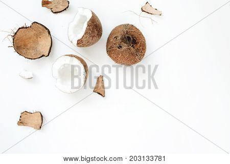 Cracked coconut on white background. Flat lat top view