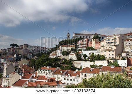 Beautiful view from Costa del Castelo street towards Augusto Gil gardens Jardim Augusto Gil with beautiful church of the Grace Igreja Convento da Graca . Alfama Lisboa Portugal poster