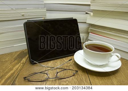 Ereader With Books, Reading Glasses And Cup Of Tea