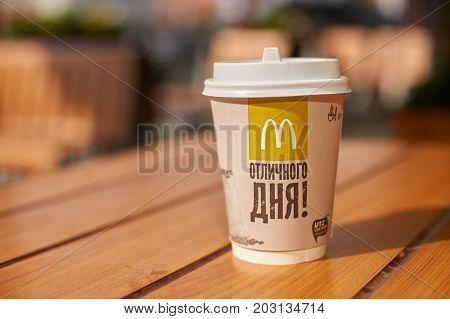 KALININGRAD, RUSSIA - CIRCA AUGUST, 2017: a cup of coffee on a table at McDonald's restaurant in Kaliningrad. McDonald's is an American hamburger and fast food restaurant chain.