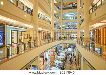 KUALA LUMPUR, MALAYSIA - APRIL 23, 2014: inside Suria KLCC shopping mall. Suria KLCC shopping centre is a six-storey building at the foot of the Petronas Twin Towers in Kuala Lumpur city centre