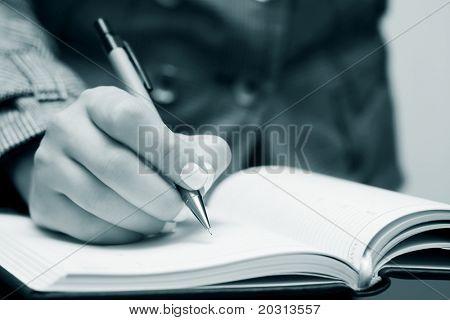 Female hand writing.
