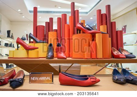 SHENZHEN, CHINA - OCTOBER 13, 2015:  shoes on display at a store in Shenzhen. Shenzhen excellent shopping choices and offers tourists great shopping opportunities.