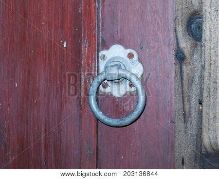 backdoor yard metal locker hanger knocker steel wooden fence gate; Essex; England; UK