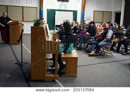 JOLIET, ILLINOIS / UNITED STATES - DECEMBER 28, 2015: A piano student performs a music recital at the Church of Jesus Christ of Latter-day Saints.