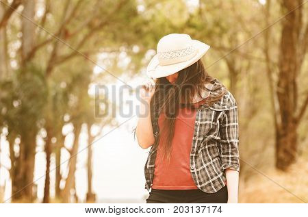 Woman Hiding Her Face With A Hat