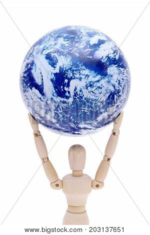wooden model dummy holding globe over head isolated on white background