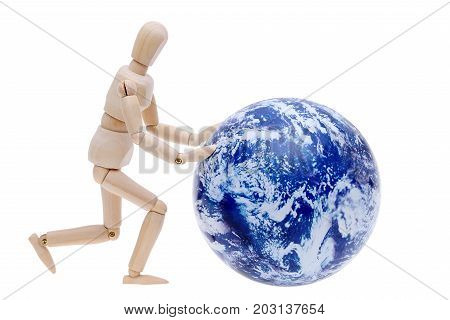 wooden model dummy hand rolling globe isolated on white background