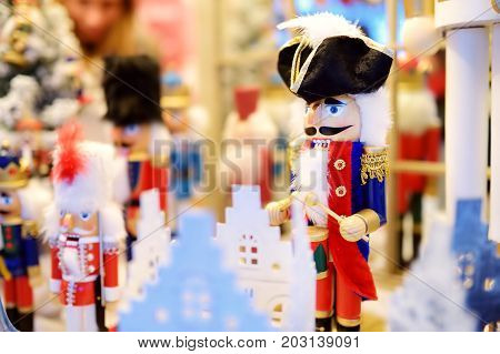 Christmas Nutcracker Sold At Christmas Market In Vilnius, Lithuania. Decorated Shopping Stands With