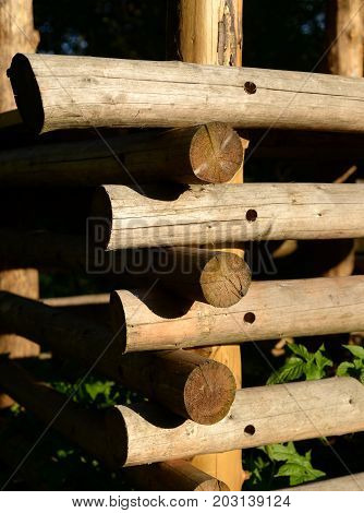Wall of a rural log house at sunny day.