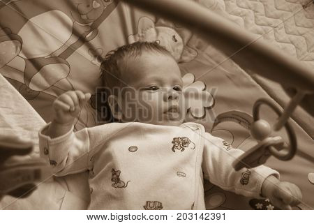 Newborn baby happy smile - face close up with dim background