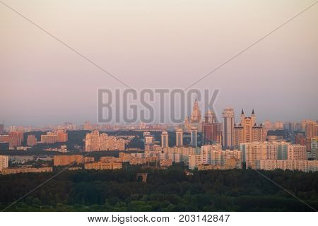 Residential area with high buidlings and green forest in Moscow, Russia at summer evening