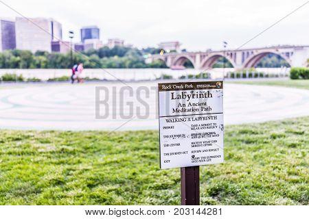 Washington Dc, Usa - August 4, 2017: Rock Creek Park Labyrinth Sign By Potomac River, Key Bridge And