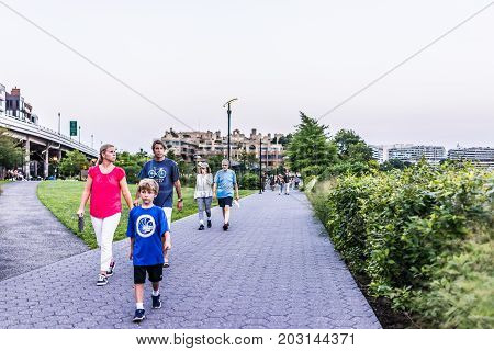 Washington Dc, Usa - August 4, 2017: Georgetown Harbor On Riverfront With Boardwalk And People Walki