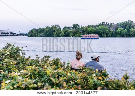 Washington Dc, Usa - August 4, 2017: Couple Sitting In Georgetown Park Harbor On Riverfront In Eveni