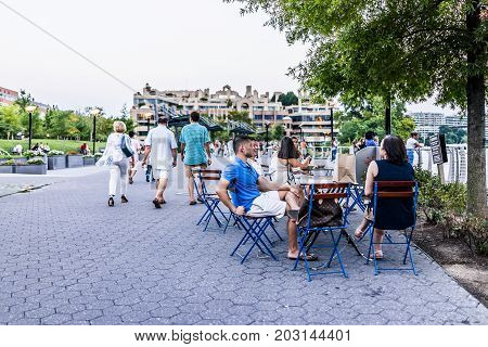 Washington Dc, Usa - August 4, 2017: Georgetown On Riverfront With Boardwalk And People Sitting, Wal